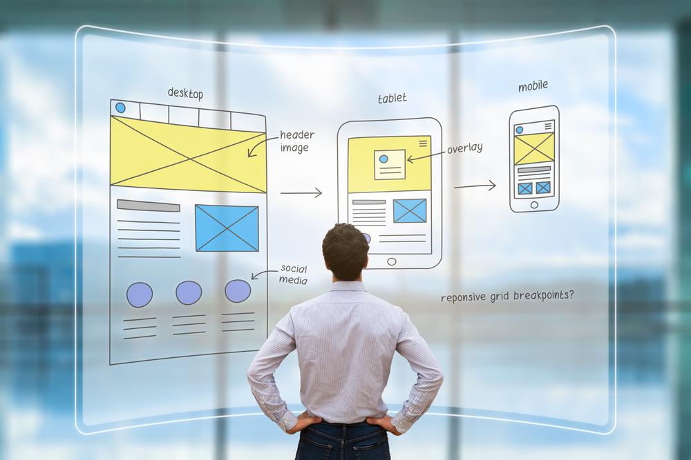 man designing a responsive website
