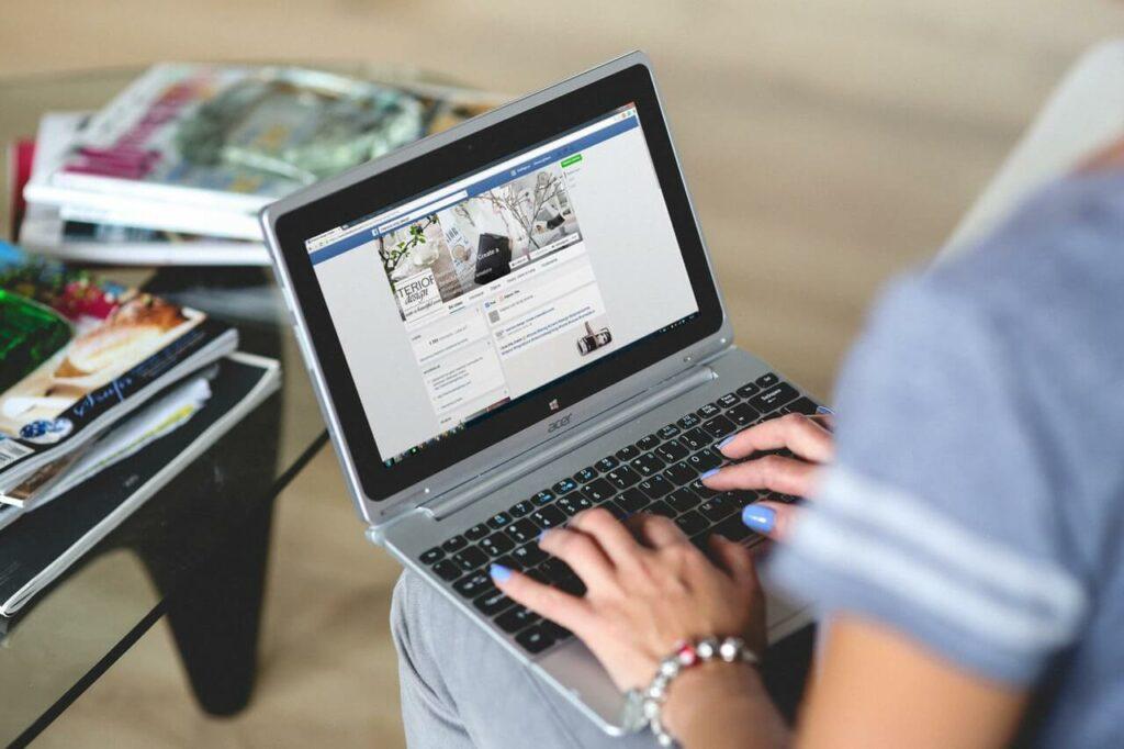 Man using facebook on laptop